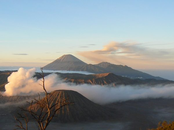 mountains in indonesia, from above, with clouds & fog